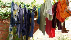 Washing hanging on the line sorted by colour