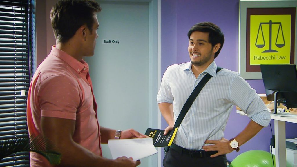 Aaron and David talking in 'Neighbours'.