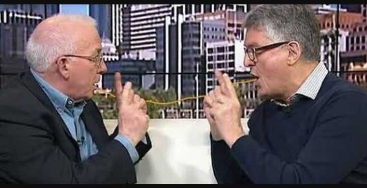 Gerard Henderson and David Marr face each other arguing