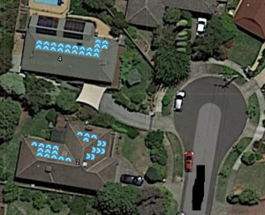 Aerial view of suburban cul-de-sac with position of solar panels marked on roofs.