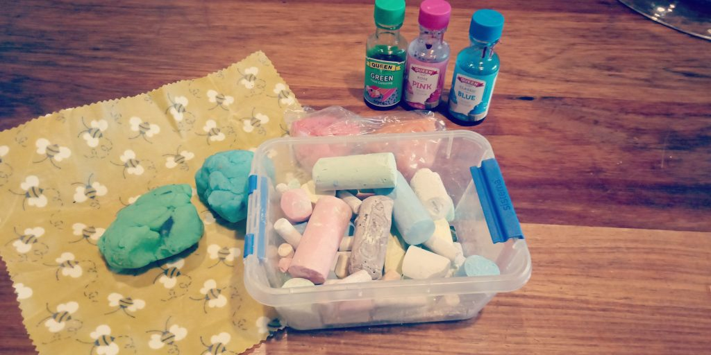 Playdough, foodcolouring and tub of chalk.